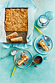 Apple pie and cheesecake tray bake slices with caramel sauce