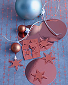 Christmas arrangement of baubles and snowflakes made from copper-coloured foil