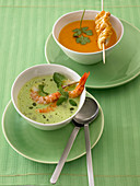 Pea soup with shrimps, and carrot soup with poultry skewers