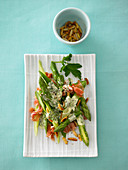 Asparagus with parma ham and roasted pine nuts