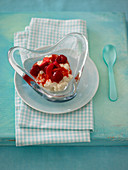 Vanilla rice pudding with fruit in a heart-shaped glass bowl