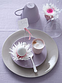 Easter place setting with cappuccino, flowers and Easter egg