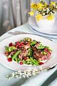 Spring lamb chops with peas, mint and redcurrants
