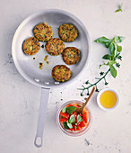 Spelt and courgette fritters with a tomato and honey dip