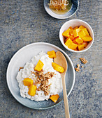 Coconut rice with mango and honey sesame seeds