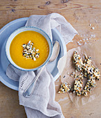Pumpkin soup with crispy almond bars