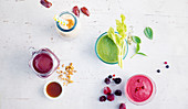 Colourful smoothies made with bananas, berries and avocado