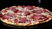 Salami pizza in an oven