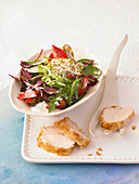 Spring salad with coconut chicken, strawberries and rose dressing