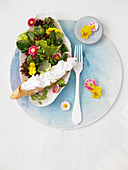 Lettuce with watercress, edible flowers, herbs and crostini