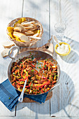 Hungarian goulash with peppers, fennel and baguette