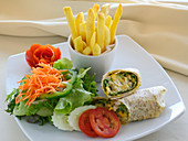 Wraps with a side salad and french fries