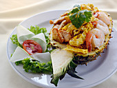 Kaow Ob Sapparod (pineapple stuffed with chicken and shrimp, Thailand)