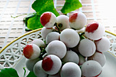 Frozen red grapes on a dish
