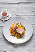 Veal fillet in a herb coat with vegetable noodles