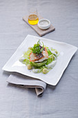 Sea bass with avocado and cucumbers