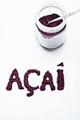 Acai berry powder: in a glass jar and lettered against a white background