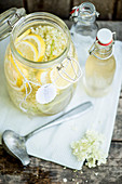 Elderflower syrup in a large jar