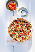 Puff pastry quiche with courgette, sun-dried tomatoes and cream cheese