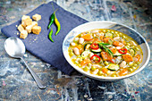 Earthy minestrone soup with fresh vegetables in broth