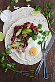 Huevos Rancheros (tortillas with beans and fried egg, Mexico)
