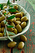 Green olives in a porcelain bowl