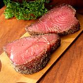 Two tuna steaks with black pepper coating