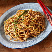 Sesame Peanut noodles with chive garnish