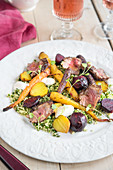 Lamb with beetroot on a bed of herb couscous