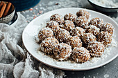 Almond and date energy balls with grated coconut
