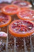 Blood orange slices being candied