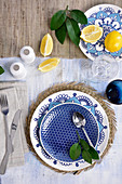 A maritime place setting in blue and white with lemons