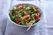 Fusilli with mushrooms, rocket and tomatoes