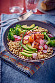 Grain salad with salmon, avocado and broccoli