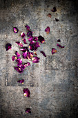Dried rose petals on an antique surface