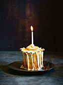 Lemon meringue cake with burning candle