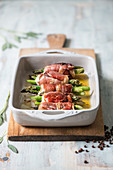 Asparagus and bacon saltimbocca with turkey fillet