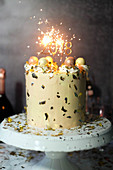A New Year's Eve cake with champagne and sparklers