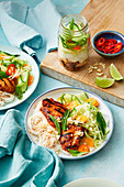 Glazed chicken fillets with chilli jam, vermicelli and salad (Asia)