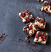 Choc-raspberry slice with coconut flakes