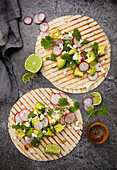 Taco wraps with avocado, radishes and feta
