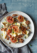 Warm figs with brie, honey and walnuts