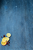 Orange, lemon, and lime slices on a blue background