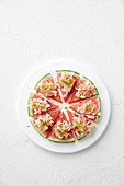 Watermelon pizza with prosciutto and feta