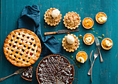 Fruit pie, chocolate cake, plum tarts, and passion fruit tarts