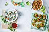 Coconut-poached chicken rice paper rolls, Peri peri chicken and rice lettuce cups