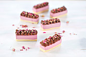 Raw raspberry and hazelnut slices, sprinkled with cocoa nibs and rose petals (vegan)