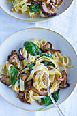 Fettuccine with spinach, mushrooms and caramelised onions