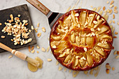 Cardamom and pear cake with honey and almond flakes