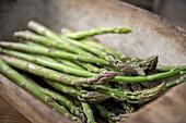 Fresh green asparagus in a box